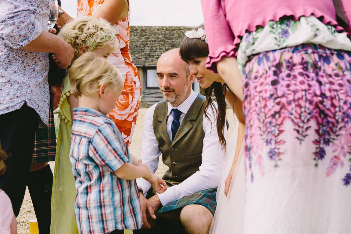 Bride and groom greeting young guests
