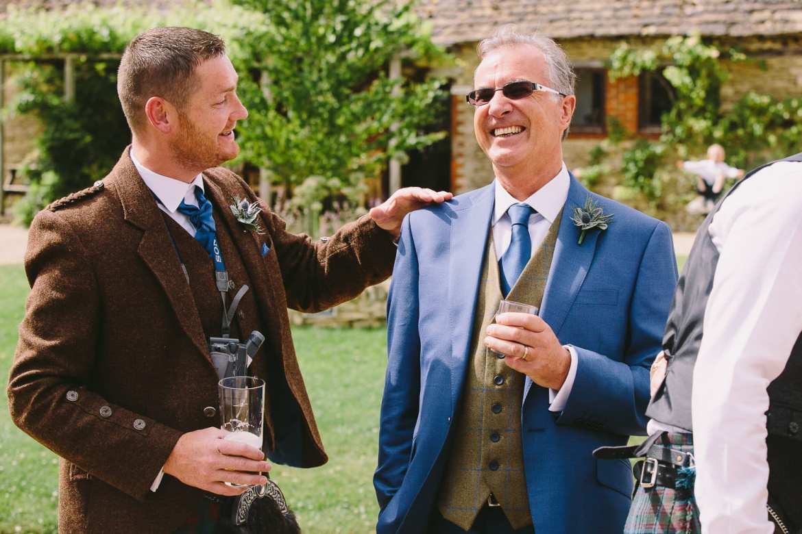 Brides father and usher enjoying a drink