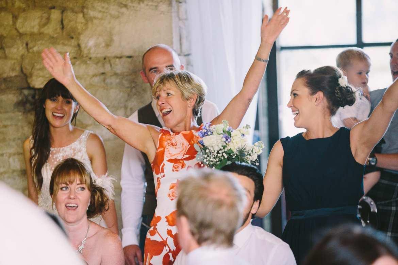 Brides mother and bridesmaid waving
