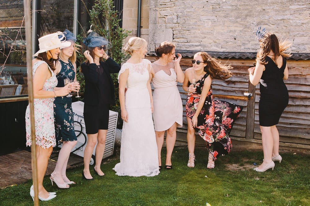 Bride and her friends outside Cripps Stone Barn