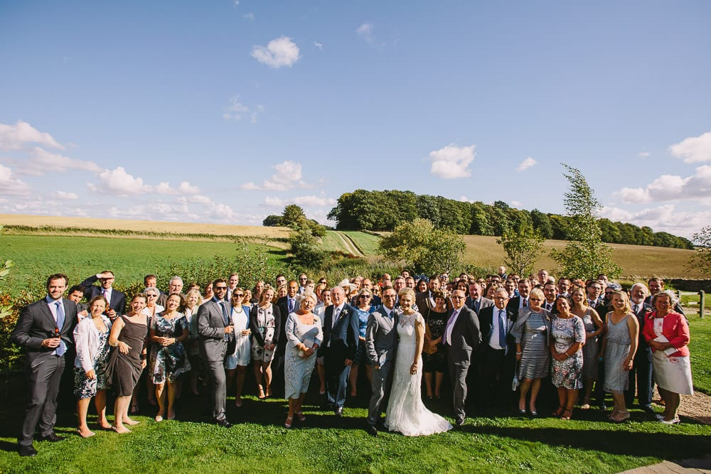 Group shot of everyone at the Cripps Stone Barn wedding