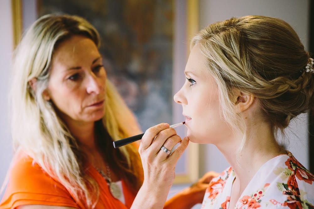Make up artist applying brides make up