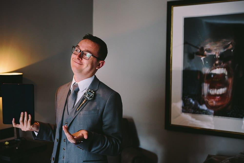 Groom getting emotional after practicing his speech in hotel room at The Wheatsheaf Inn