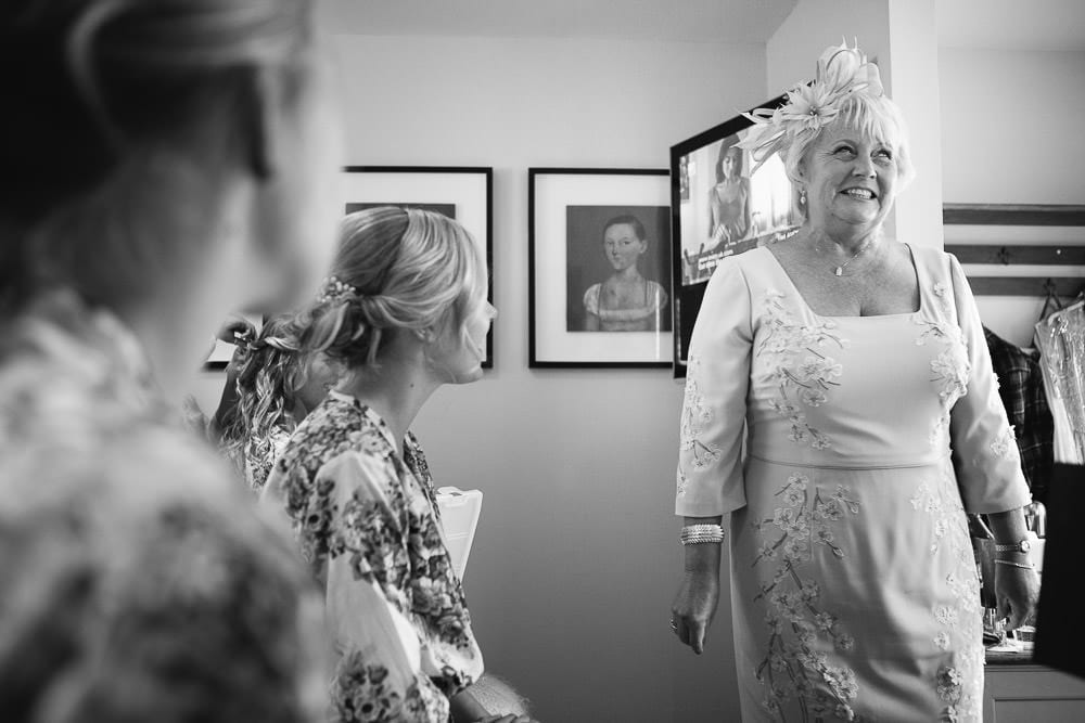 Grooms mother with the bride and bridesmaids getting ready