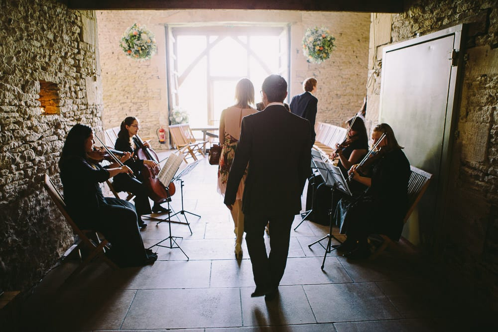 View of the guests coming into the ceremony room at Cripps Stone Barn