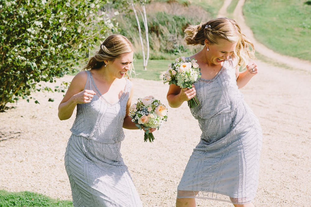 Bridesmaids dancing in the gardens of Cripps Stone Barn
