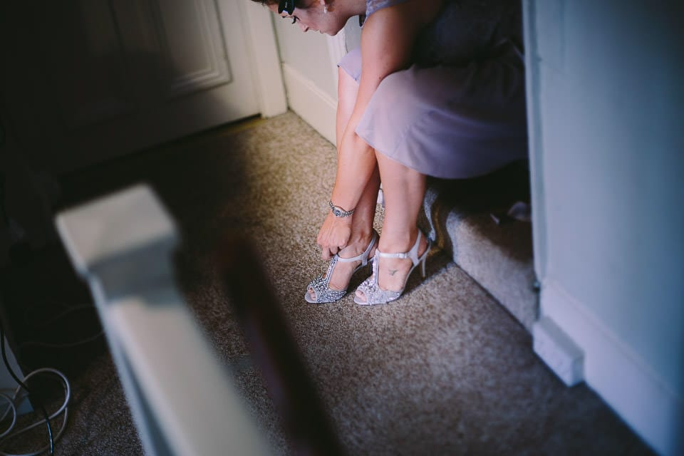 Bridesmaid putting on her shoes