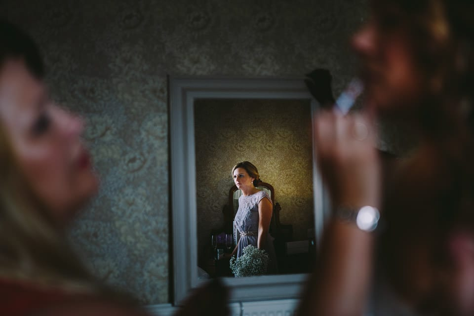 Image of bridesmaid in mirror
