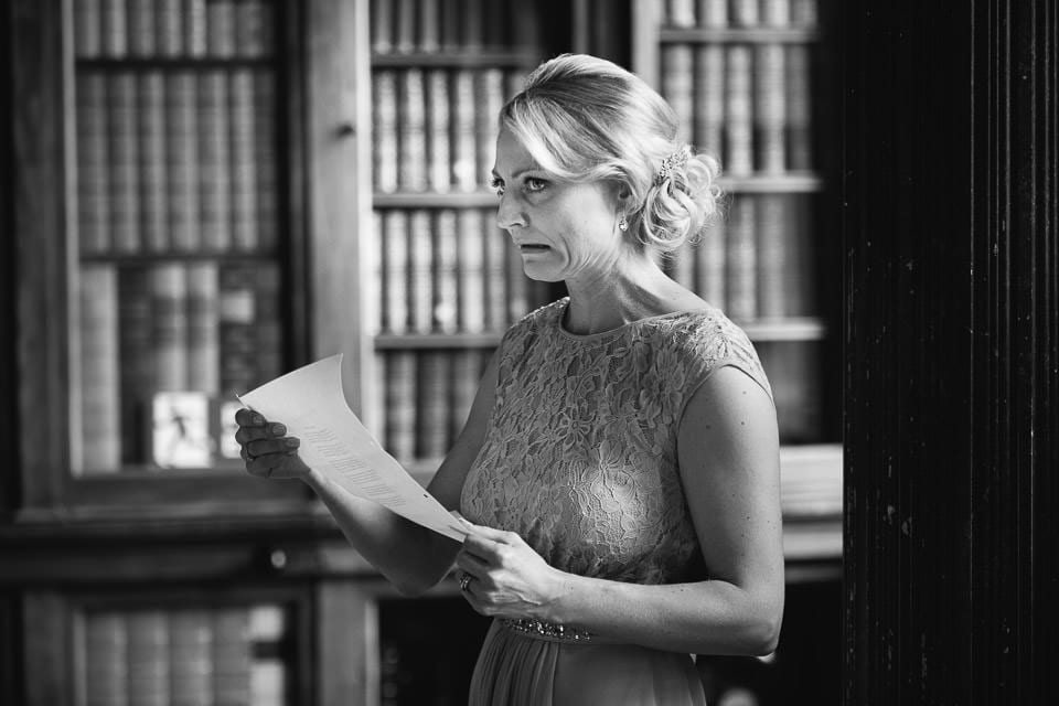 Black and white image of bridesmaid doing reading