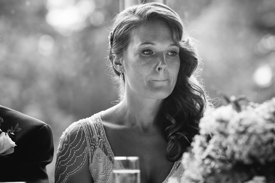 Black and white image of brides emotion during speech