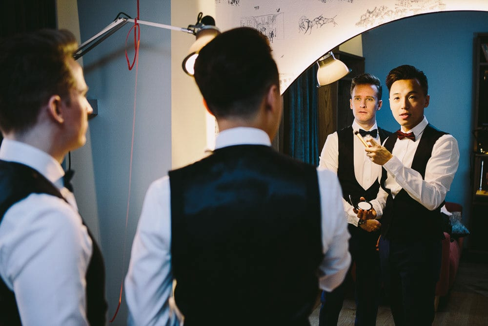 Reflection of grooms in the large mirror at The Hoxton London