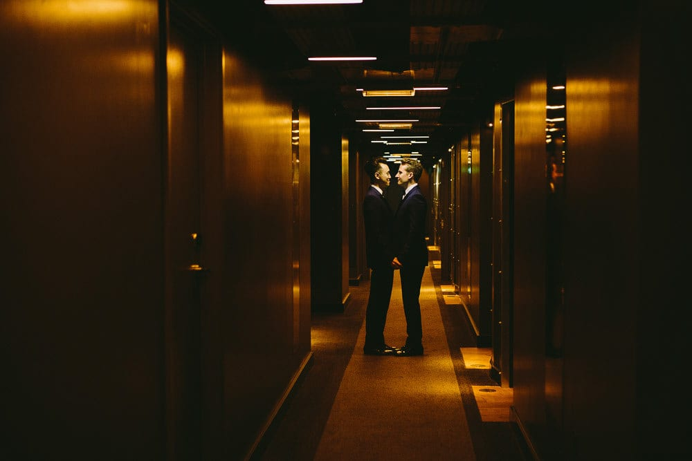 Grooms standing face to face in the corridor in The Hoxton London