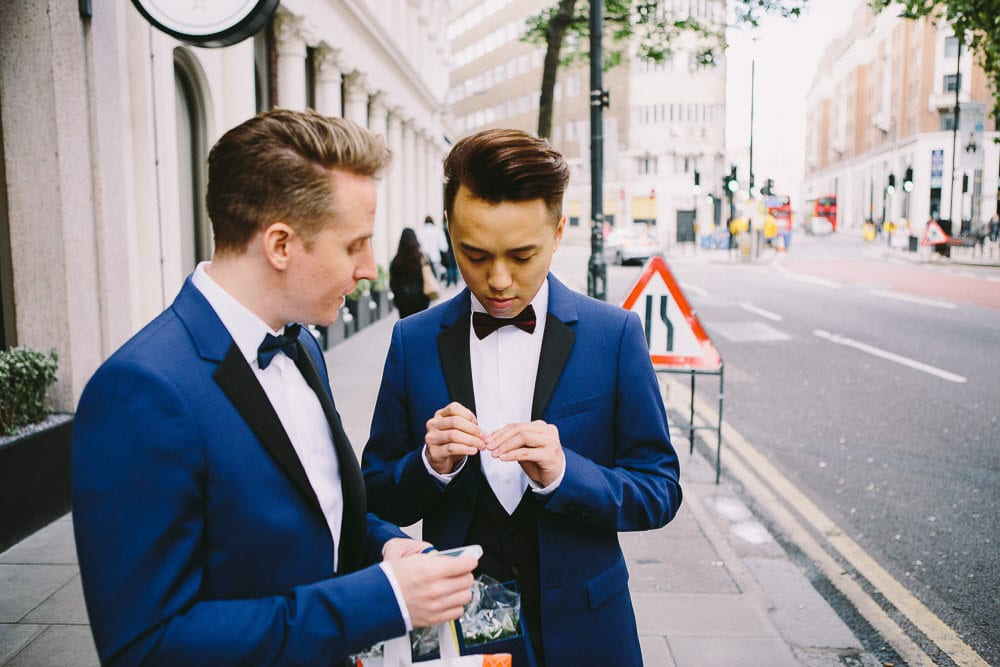 Both grooms waiting for the car to take them to their wedding