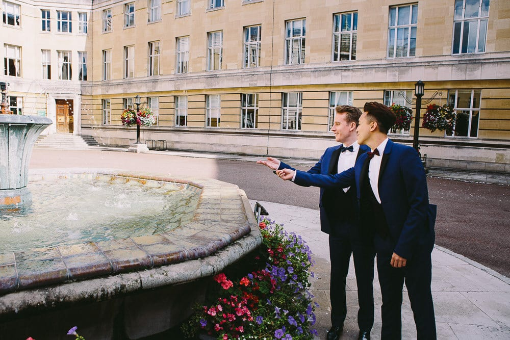 Both grooms by the fountain outside Wandsworth Town Hall
