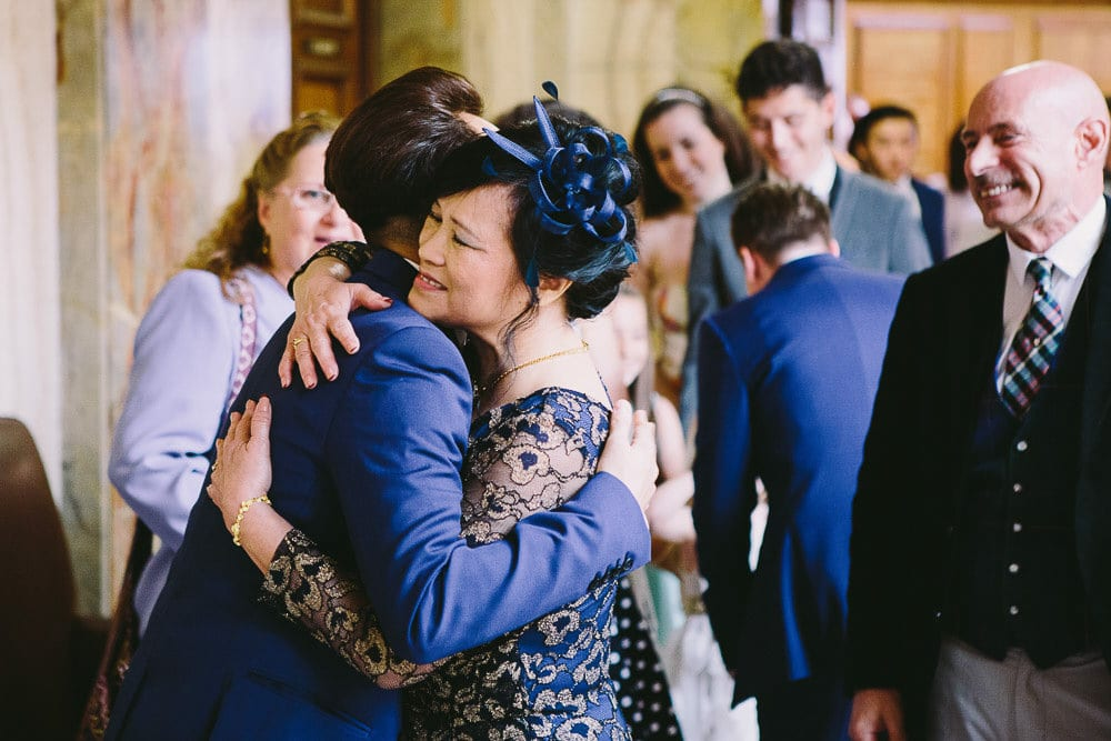 Groom hugging his mother at Wandsworth Town Hall