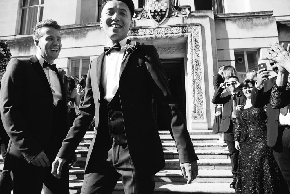 Grooms walking down the steps outside Wandsworth Town Hall