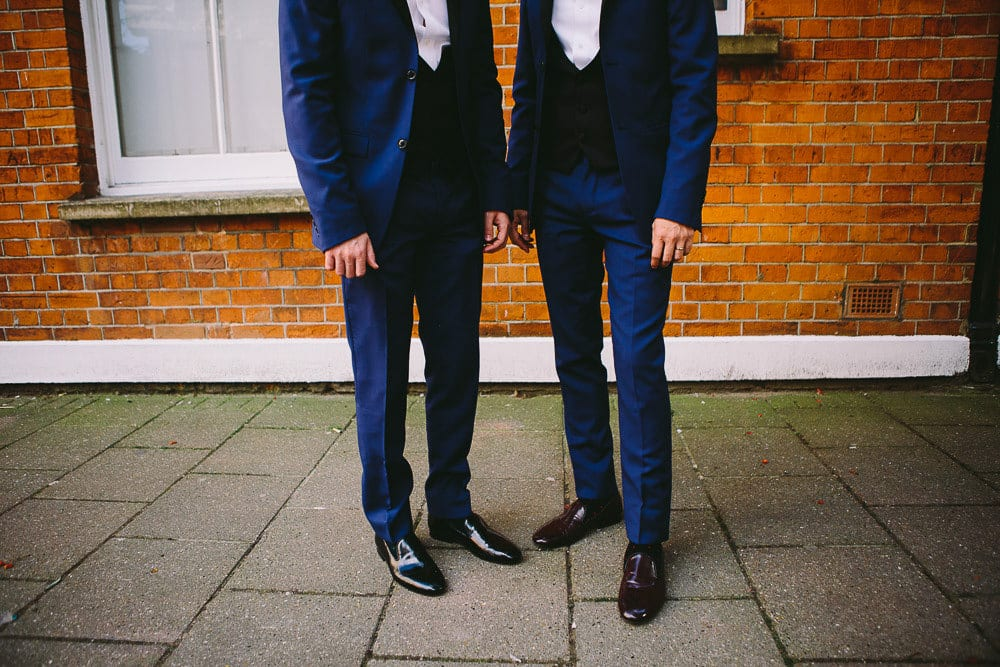 Both grooms standing outside The Hoxton London