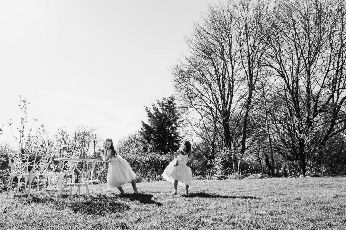 Flower girls playing in the gardens at The Great Tythe Barn Tetbury