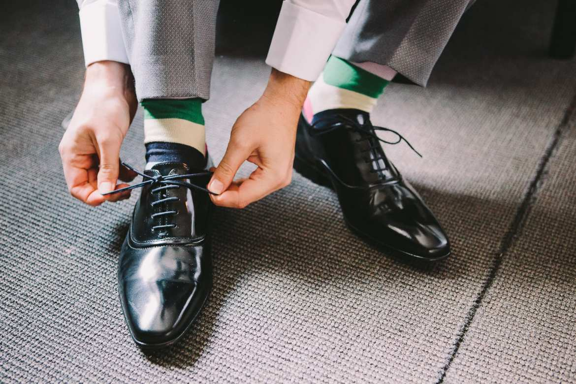 Groom tying his shoelaces