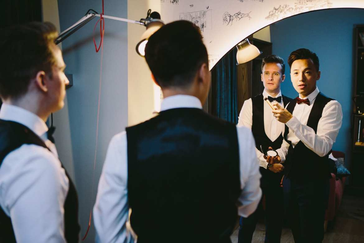 Image of couple in mirror getting ready