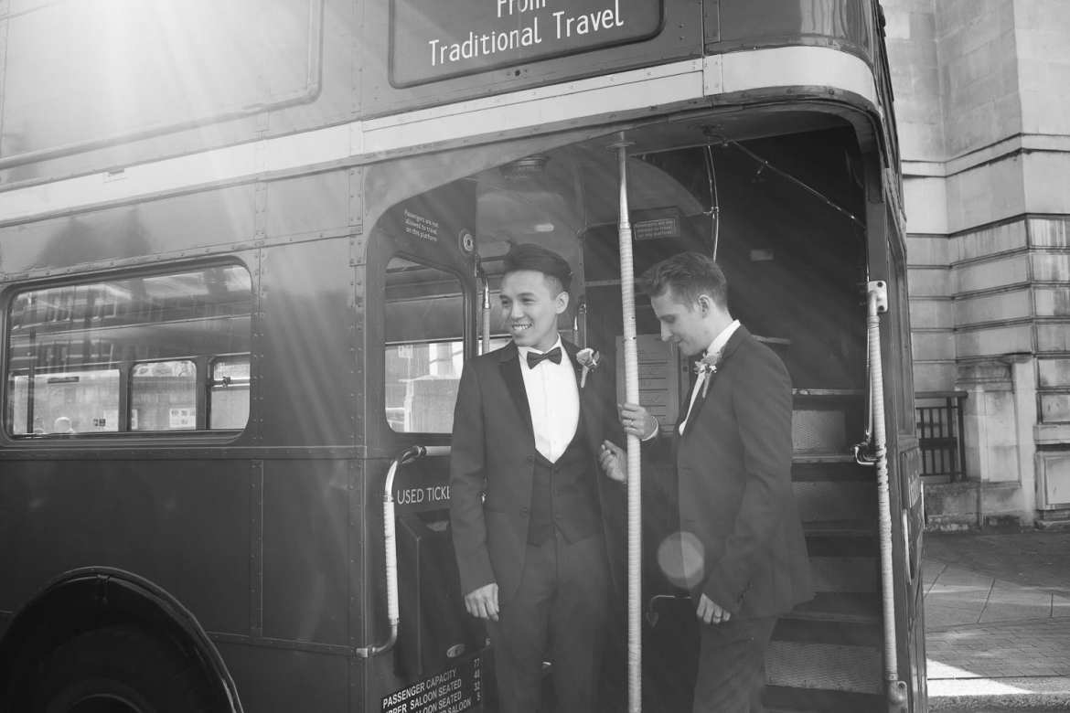 Black and white image of couple on vintage London bus