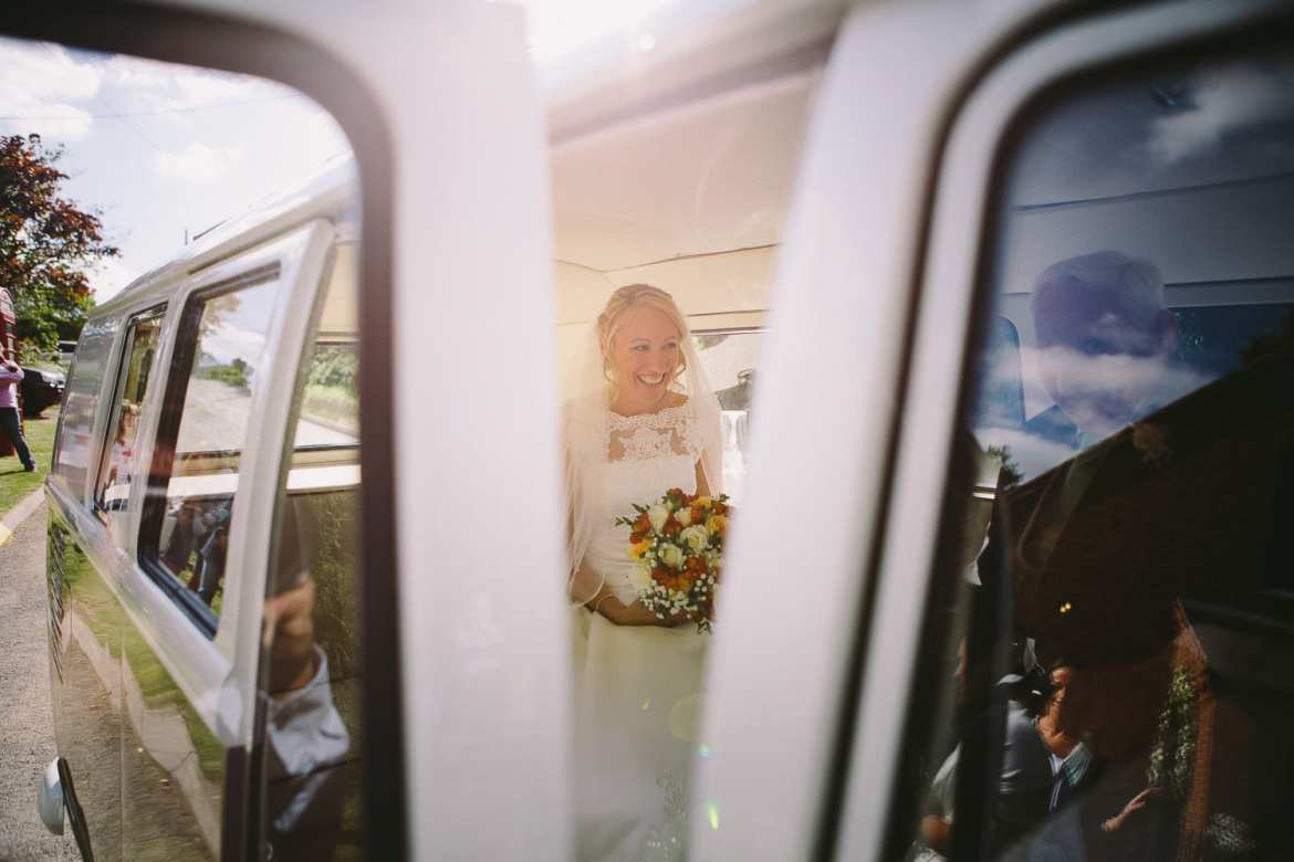 Bride arriving at church in VW Camper