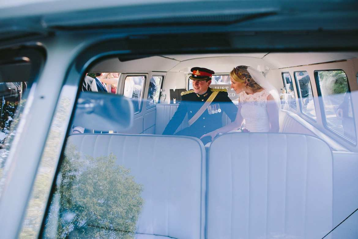 Couple in VW Camper van leaving church