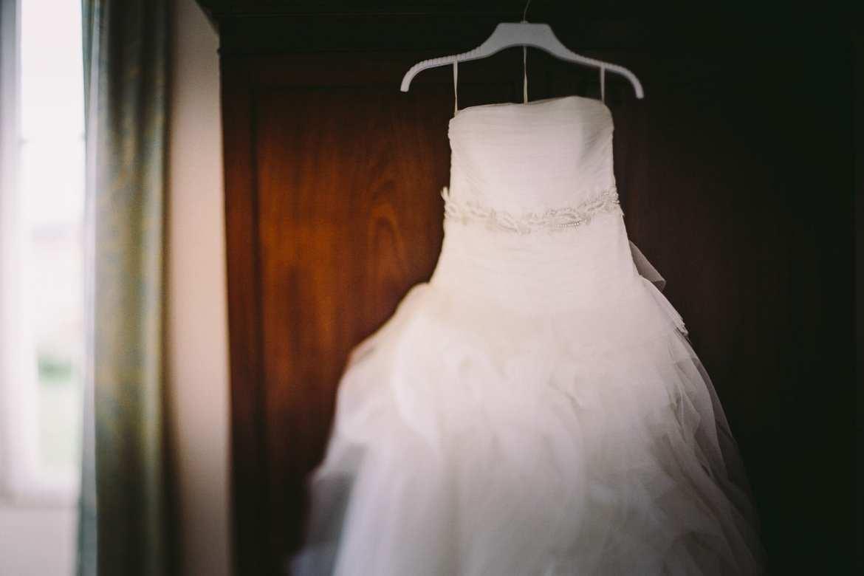 The wedding dress hanging up