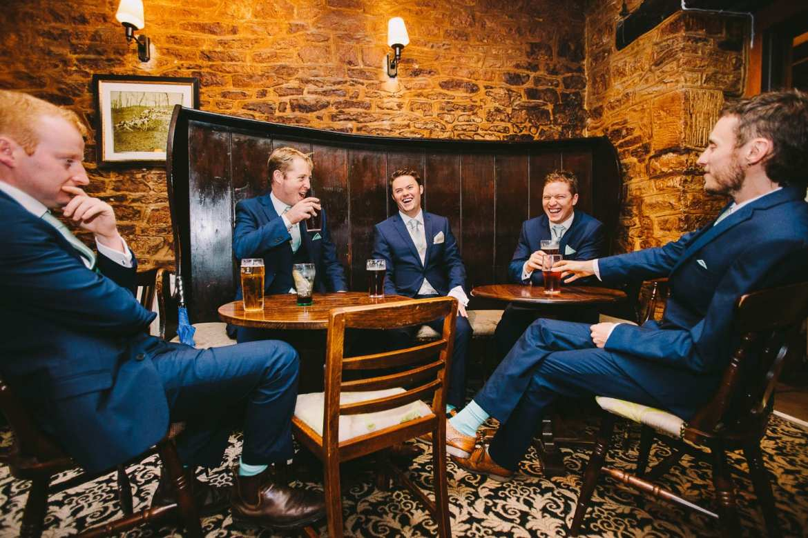 The groom and groomsmen in the pub