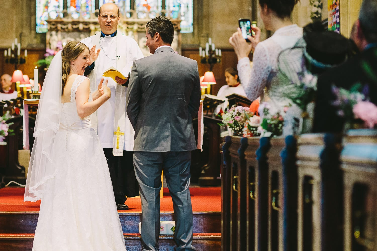 Bride gives her guests the thumbs up