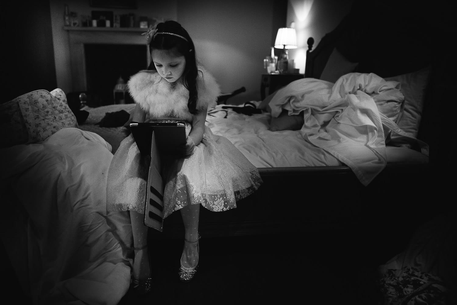a flower girl playing on an ipad
