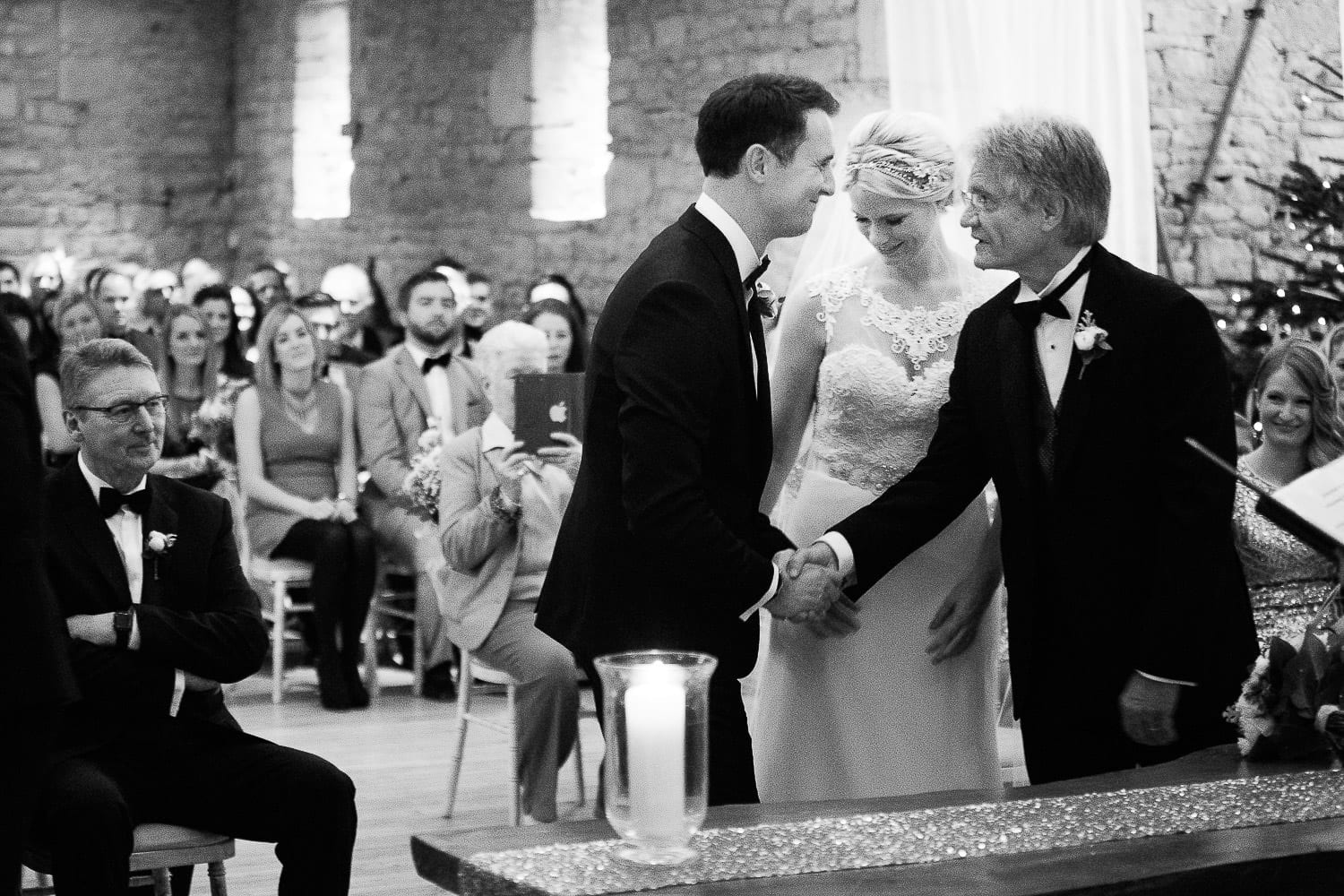 Father of the bride and groom shaking hands