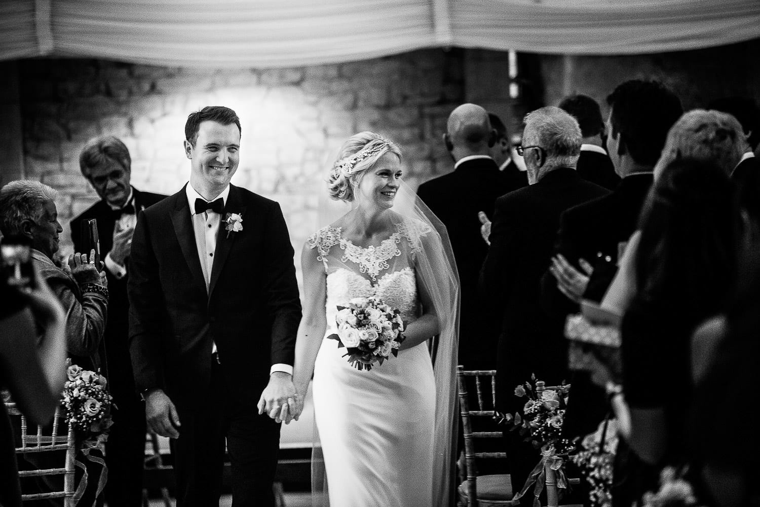 Black and white image of bride and groom's exit