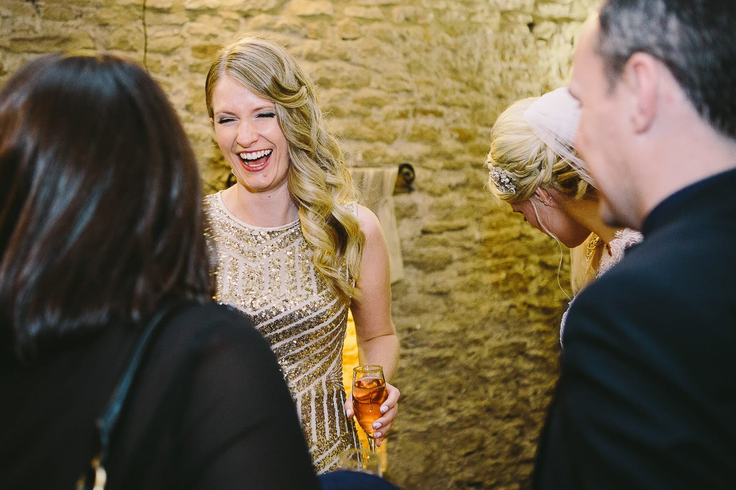 Bridesmaid laughing during drinks