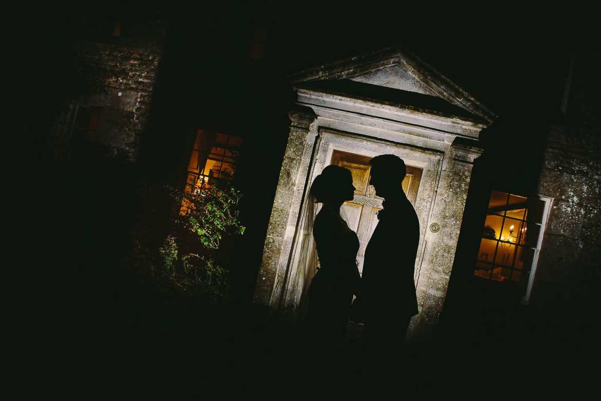 Silhouette of bride and groom outside the front door