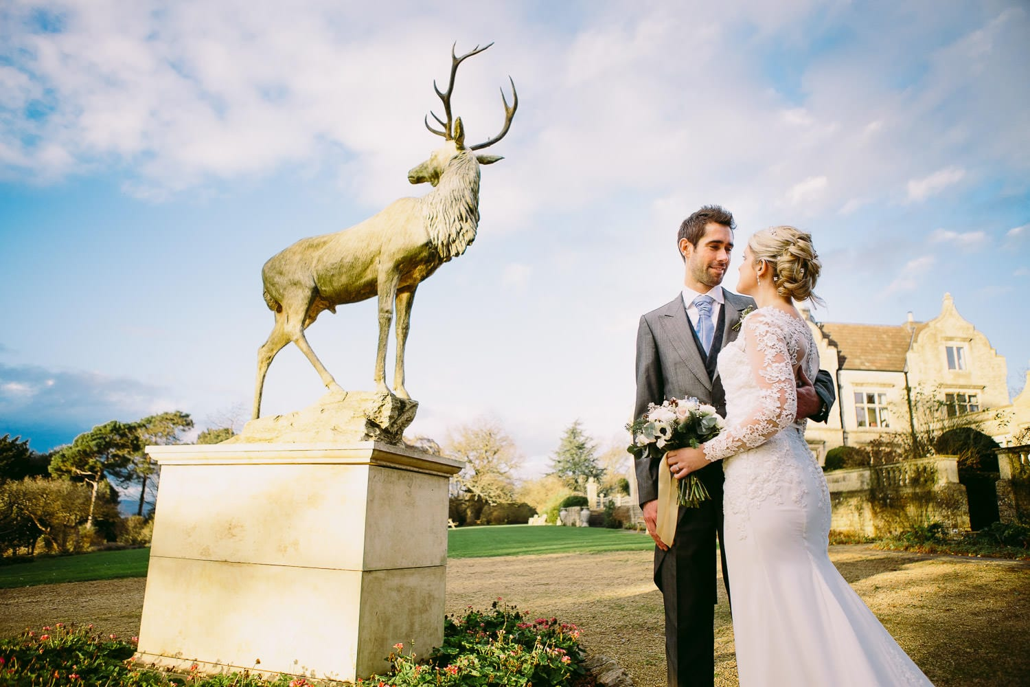 A bride and groom portrait in front of Old Down Manor