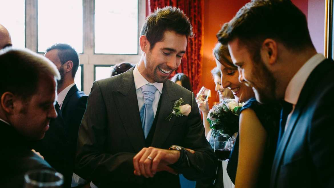 The groom shows off his new watch