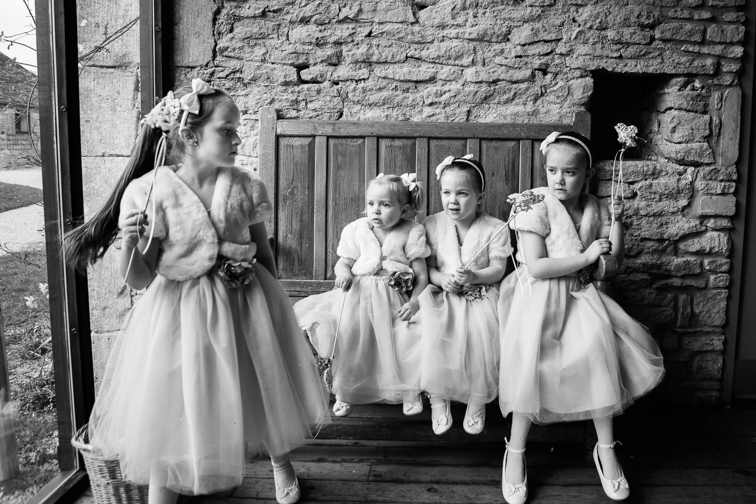 The flower girls sat in a row