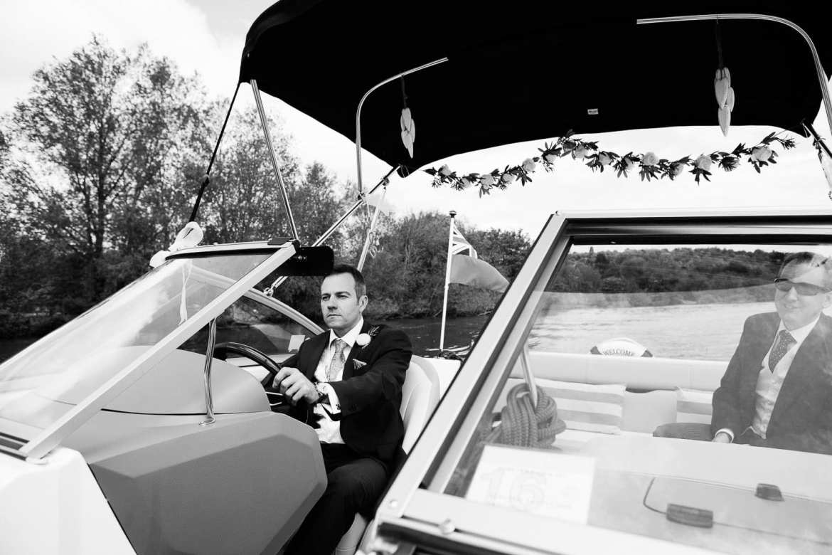 The groom driving the boat into Henley