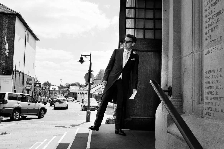 Usher standing on one leg outside Henley Town Hall