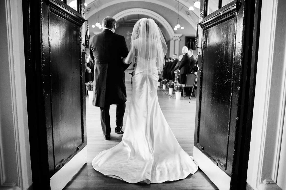 Bride and her father enter Henley Town Hall for the wedding ceremony