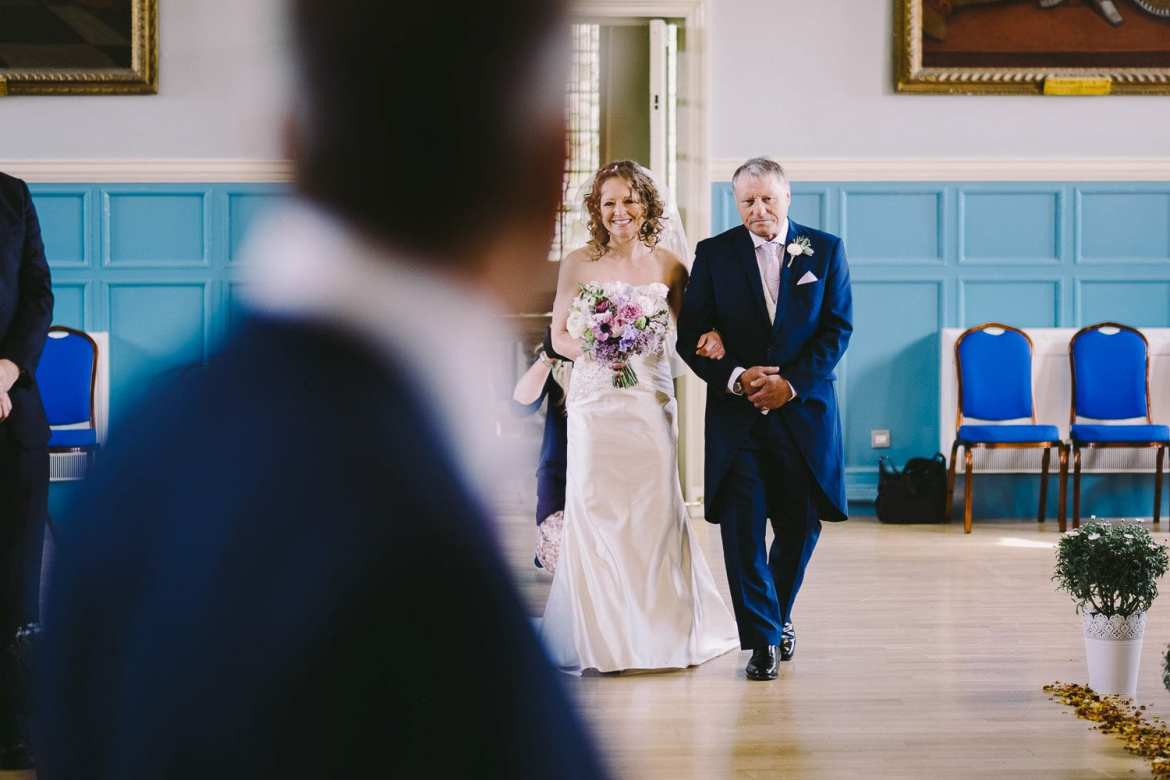 Bride and her father walking up the aisle in Henley Town Hall