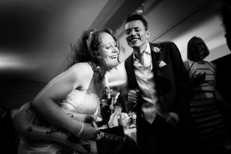Bride dancing with groomsman at Greenlands