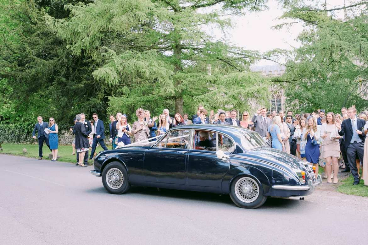 The wedding car leaves the church