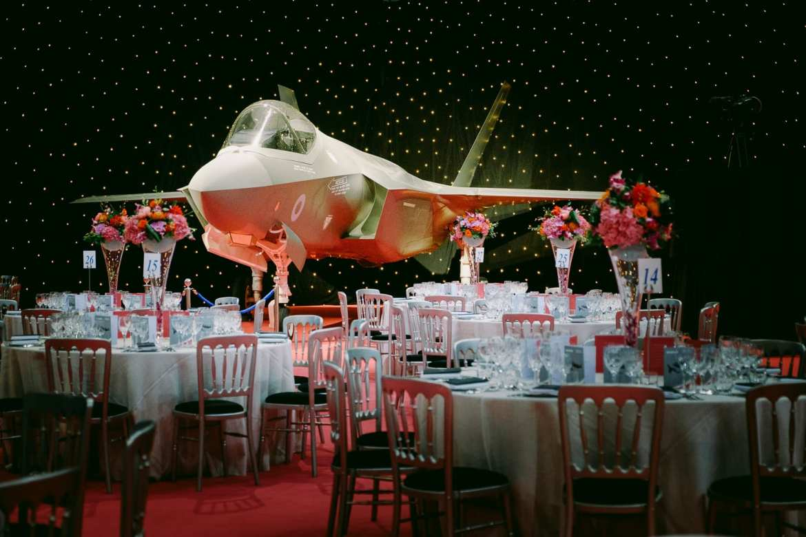 The romm set up for the gala dinner with an F35 Lightning 2