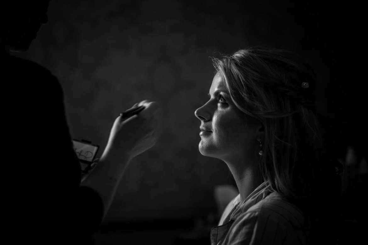 The maid of honour having her makeup done