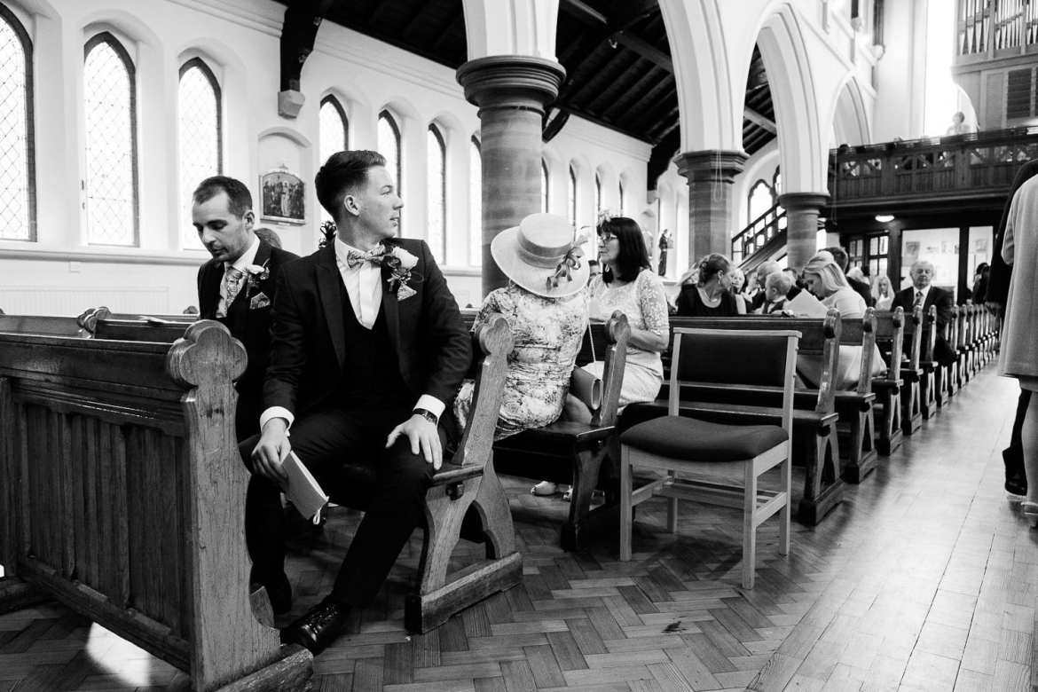 The groom waits in the church