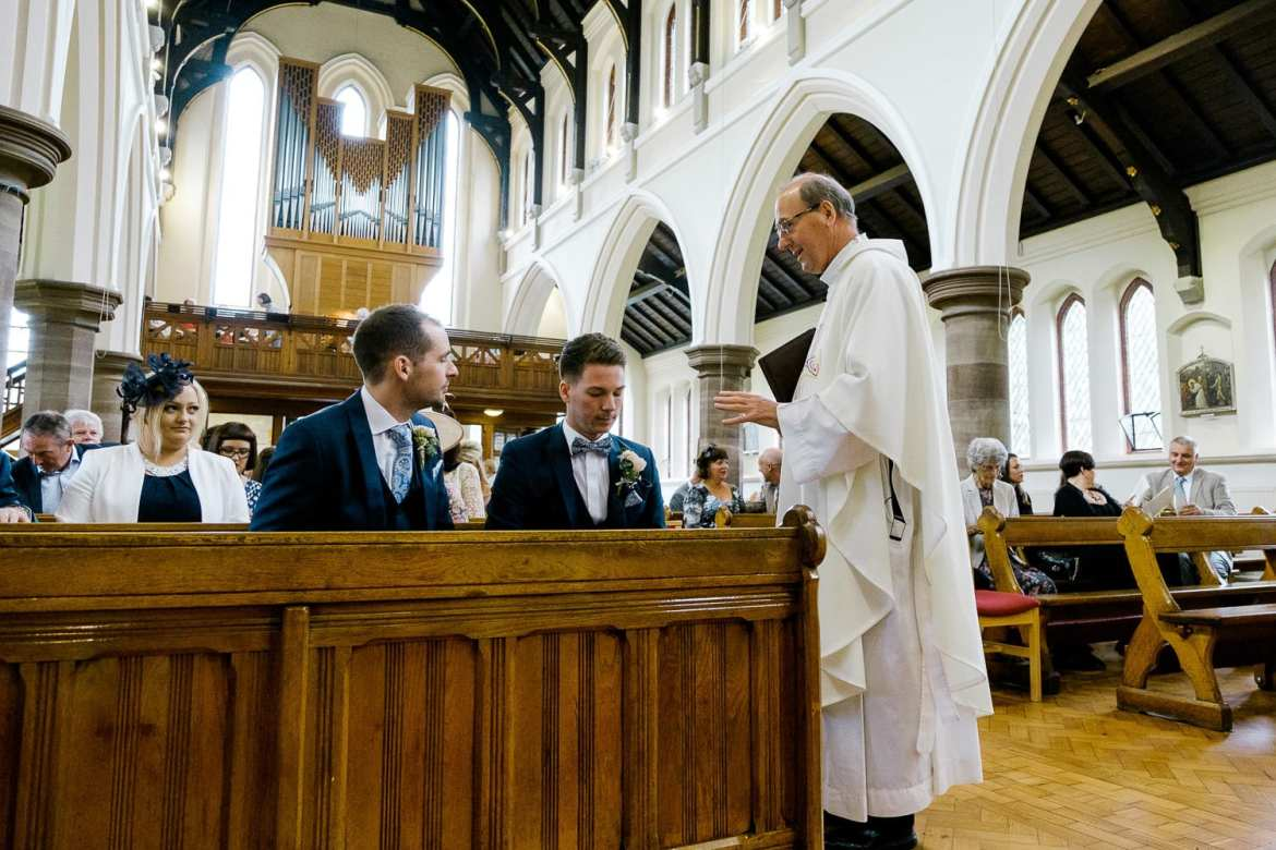 The vicar talks to the groom