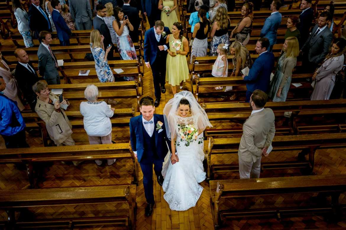 The newlyweds exit the church