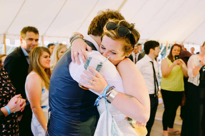 The bride hugs her dad